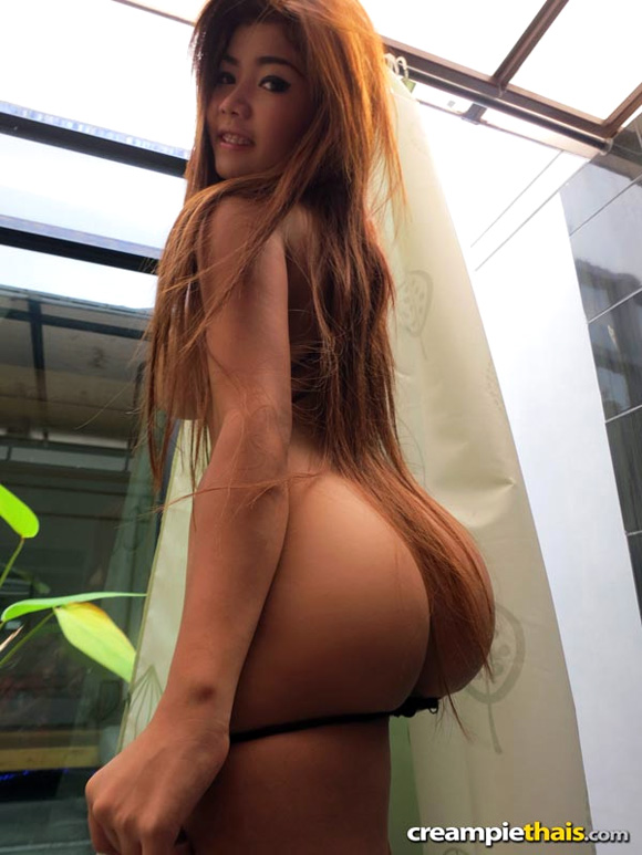 big-tit-thai-hooker-poses-and-strips-to-show-all