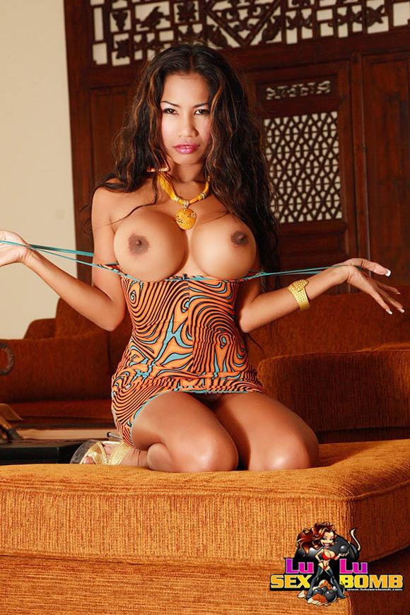 double-d-tits-on-petite-thai-tattooed-brunette
