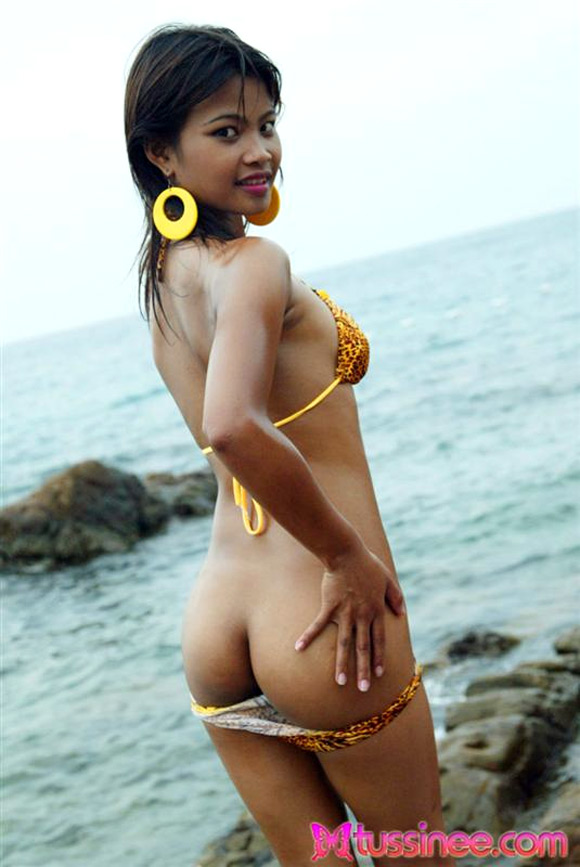 tussinee-is-at-the-beach-taking-pics-in-her-yellow-bikini